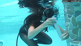 Girl in scuba together with pantyhose Diana Kalgotkina is toying pussy under get under one's water
