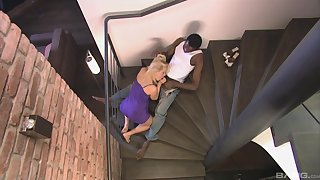 Katy Sweet deals the black monster overhead the stairs