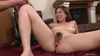 Asian beauty soaks her hairy cunt relating to fond sperm