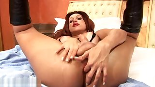 Redhead shemale has significant balls full of cum but undersized penis