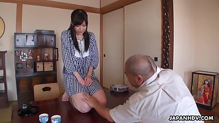 Pretty housekeeper Shiori Mizoguchi serves the brush older and his guest